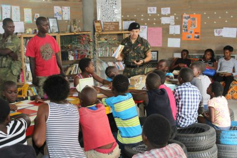 a ranger talks to a classroom of children