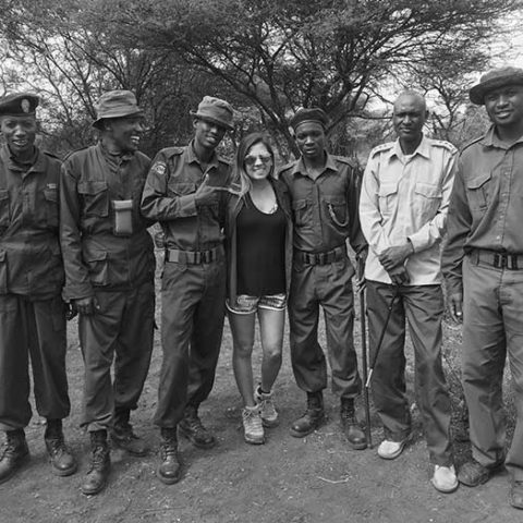 a woman and six rangers standing and posing for a photo